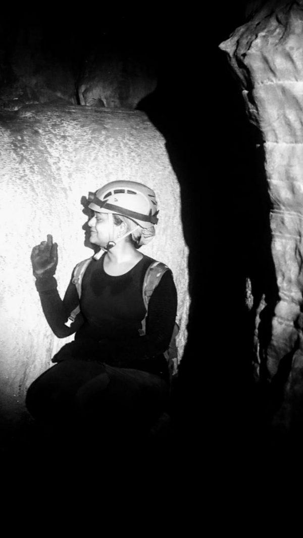 Me sitting near a speleothem inside Mayavi caves
