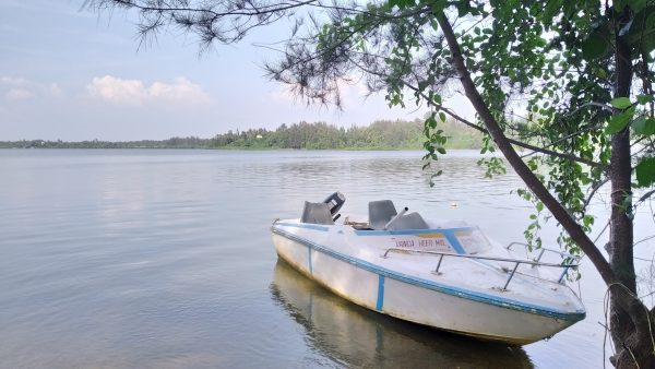 Boat parked at landing site- water calm - survival island